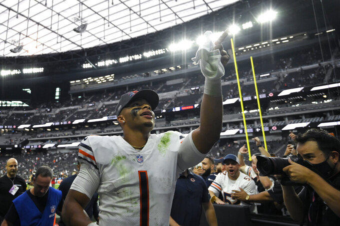 Chicago Bears quarterback Justin Fields (1) runs off the field after the Chicago Bears defeated the Las Vegas Raiders in an NFL football game, Sunday, Oct. 10, 2021, in Las Vegas. (AP Photo/David Becker)