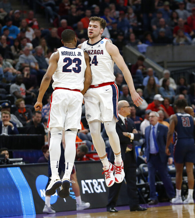 Gonzaga's Corey Kispert (24) celebrates with Zach Norvell Jr. (23) after scoring against Fairleigh Dickinson during the first half of a first-round game in the NCAA men's college basketball tournament Thursday, March 21, 2019, in Salt Lake City. (AP Photo/Rick Bowmer)