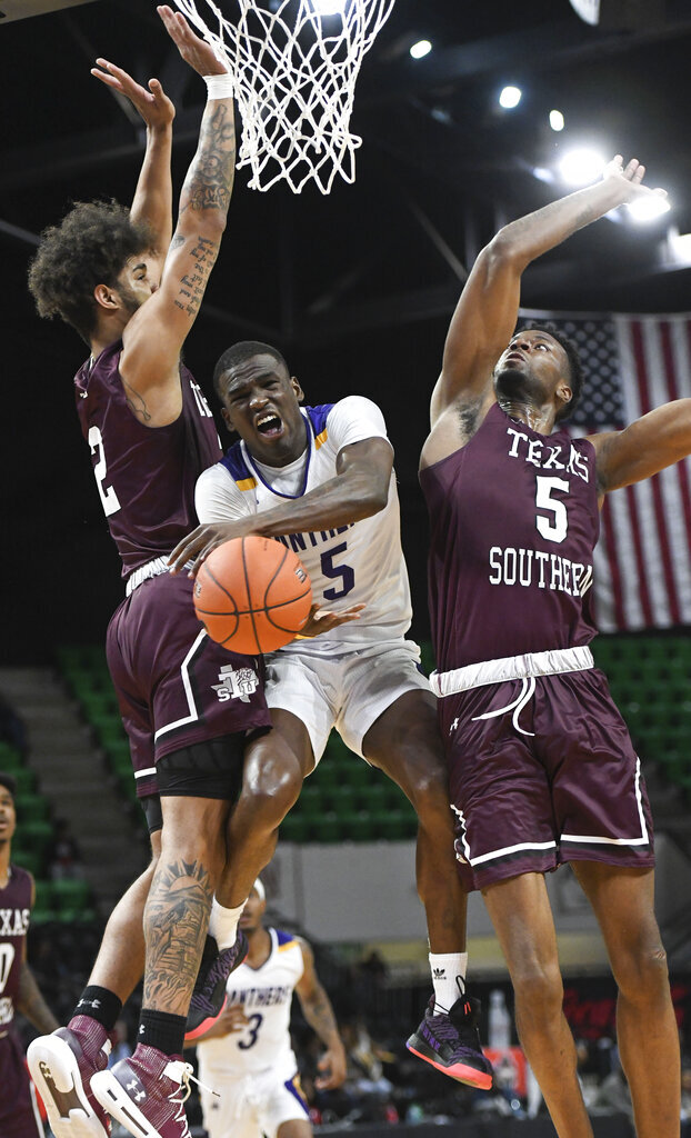 Texas Southern forward Eden Ewing (2) and Texas Southern center Trayvon Reed (5) defend a shot by Prairie View A&M forward Devonte Patterson (5) during the second half of the SWAC NCAA college championship basketball game Saturday, March 16, 2019, in Birmingham, Ala. (AP Photo/Julie Bennett)