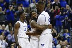 Seton Hall's Myles Powell, center, hugs Romaro Gill, right, during the first half of an NCAA college basketball game against Providence Wednesday, Jan. 22, 2020, in Newark, N.J. (AP Photo/Frank Franklin II)