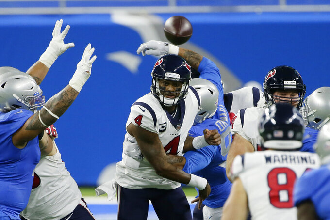 Houston Texans quarterback Deshaun Watson (4) throws under pressure during the first half of an NFL football game against the Detroit Lions, Thursday, Nov. 26, 2020, in Detroit. (AP Photo/Duane Burleson)