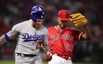 Los Angeles Dodgers' Alex Verdugo, left, beats Los Angeles Angels relief pitcher Felix Pena to first during the fourth inning of a baseball game Tuesday, June 11, 2019, in Anaheim, Calif. (AP Photo/Mark J. Terrill)