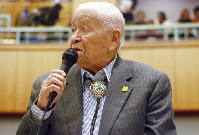 FILE - In this Feb. 2, 2018, fle photo Democratic New Mexico state Sen. John Pinto talks about his career as a lawmaker on American Indian Day in the Legislature on  in Santa Fe, N.M. Pinto joined the Senate in 1977 and is 92 years old. He was a Marine who trained as a Navajo code talker during World War II. His singing of the