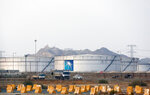 FILE - This Sept. 15, 2019 file photo, shows storage tanks at the North Jiddah bulk plant, an Aramco oil facility, in Jiddah, Saudi Arabia. Saudi Arabia's state-owned oil company Aramco on Thursday, Dec. 5, 2019, set a share price for its IPO — expected to be the biggest ever — that puts the value of the company at $1.7 trillion, more than Apple or Microsoft. (AP Photo/Amr Nabil, File)