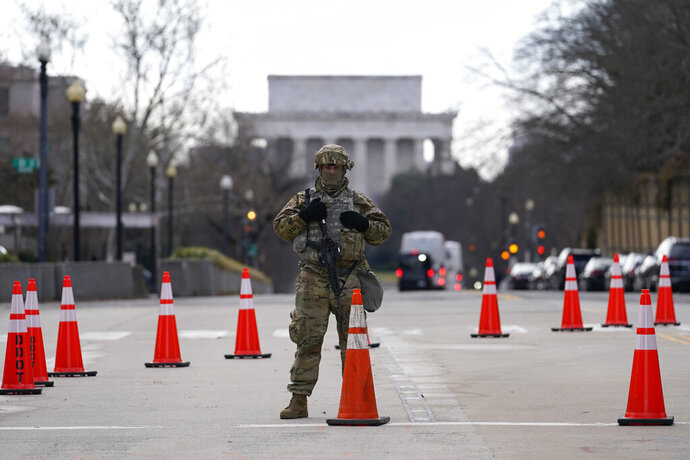 A National Guard stands at a road block near the Supreme Court ahead of President-elect Joe Biden's inauguration ceremony, Wednesday, Jan. 20, 2021, in Washington. (AP Photo/Gerald Herbert)