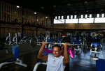 In this June 9, 2019 photo, Mexican bodybuilder Carlos Suarez trains for the upcoming Pan Am Games with Martha Elizabeth Sanchez, a former champion bodybuilder turned trainer, at the Mexican Olympic Committee facilities in Mexico City. Suarez and female fitness competitor Xyomara Valdivia will become the first Mexicans to represent their country in bodybuilding at the Pan Am Games, with this year marking the first time the discipline has been included as an official sport(AP Photo/Rebecca Blackwell)