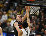 Oregon State forward Kylor Kelley, left, tosses the ball over Colorado guard Tyler Bey for a basket in the first half of an NCAA college basketball game Sunday, Jan. 5, 2020, in Boulder, Colo. (AP Photo/David Zalubowski)
