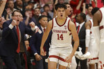 Stanford coach Jerod Haase, left, and players react after forward Spencer Jones (14) made a 3-point basket during the second half of the team's NCAA college basketball game against California in Stanford, Calif., Thursday, Jan. 2, 2020. (AP Photo/Jeff Chiu)