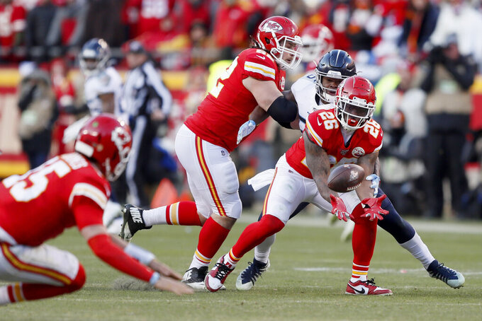 Kansas City Chiefs' Damien Williams (26) can't catch a pass during the second half of the NFL AFC Championship football game against the Tennessee Titans Sunday, Jan. 19, 2020, in Kansas City, MO. (AP Photo/Charlie Neibergall)