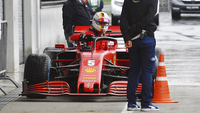 Ferrari driver Sebastian Vettel of Germany leaves his car at the end of the qualifying session for the Styrian Formula One Grand Prix at the Red Bull Ring racetrack in Spielberg, Austria, Saturday, July 11, 2020. The Styrian F1 Grand Prix will be held on Sunday. (Joe Klamar/Pool via AP)
