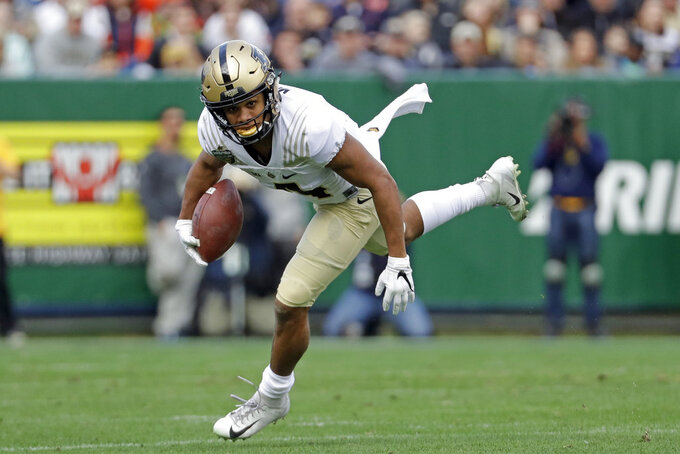 Purdue wide receiver Rondale Moore carries the ball against Auburn in the first half of the Music City Bowl NCAA college football game Friday, Dec. 28, 2018, in Nashville, Tenn. (AP Photo/Mark Humphrey)