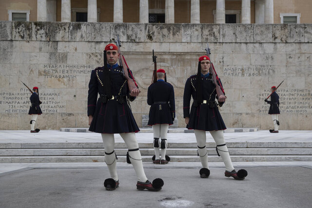 Members of the Presidential Guard perform during of the changing of the guards ceremony at the tomb of the unknown soldier in central Athens, on Tuesday, Jan. 21, 2020. (AP Photo/Petros Giannakouris)