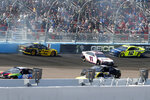 Brad Keselowski (2) and Denny Hamlin (11) and Ryan Blaney (12) crash during lap 65 of a NASCAR Cup Series auto race at Phoenix Raceway, Sunday, March 8, 2020, in Avondale, Ariz. (AP Photo/Ralph Freso)