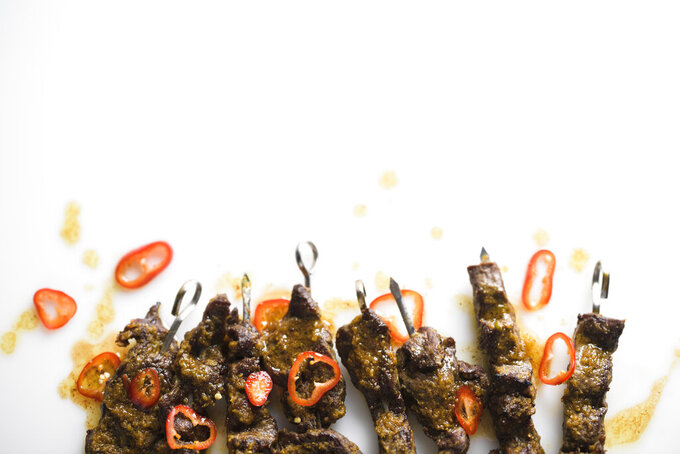 This image released by Milk Street shows a recipe for Curried Beef Skewers. (Milk Street via AP)