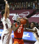 Virginia Tech's Cordell Pemsl (35) left, and Nahiem Alleyne (4) defend Clemson's Aamir Simms 25 in the second half of an NCAA  college basketball game in Blacksburg Va., Tuesday, Dec. 15, 2020.  (Matt Gentry/The Roanoke Times via AP, Pool)