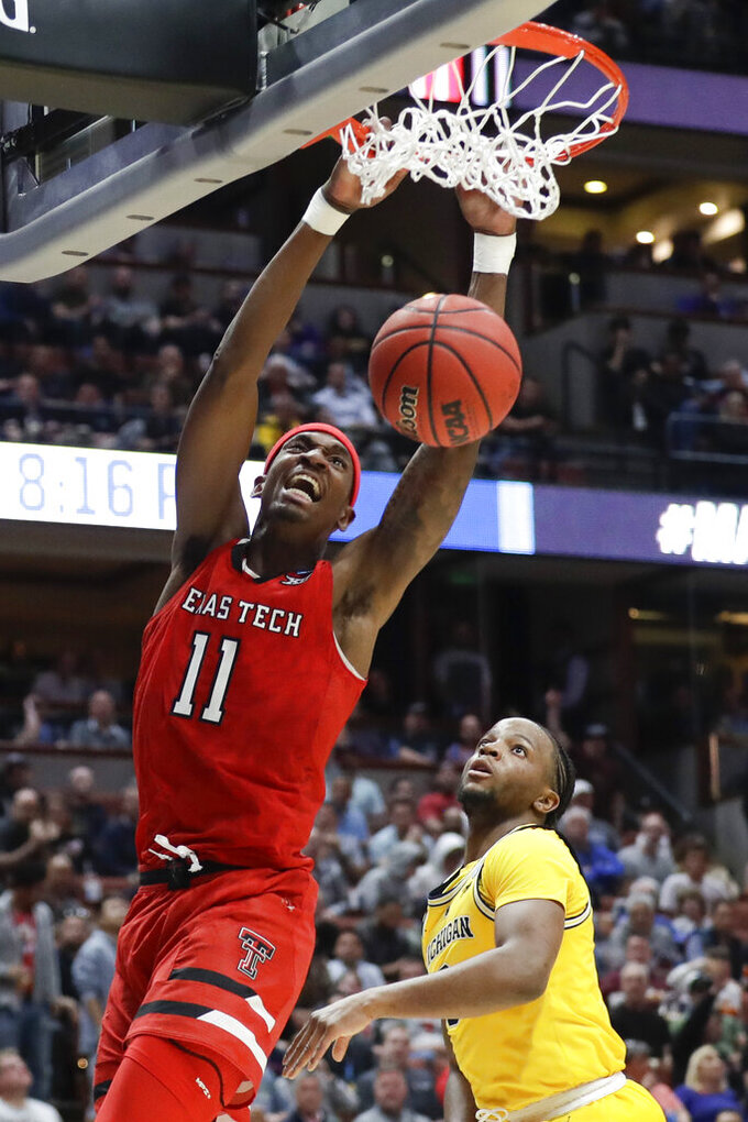 Texas Tech forward Tariq Owens dunks against Michigan during the second half an NCAA men's college basketball tournament West Region semifinal Thursday, March 28, 2019, in Anaheim, Calif. (AP Photo/Marcio Jose Sanchez)