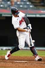 Cleveland Indians' Yu Chang hits a one-run double during the eighth inning of a baseball game against the Boston Red Sox, Sunday, Aug. 29, 2021, in Cleveland. (AP Photo/Ron Schwane)