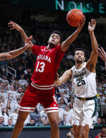 Indiana's Juwan Morgan (13) and Michigan State's Kenny Goins reach for a rebound during the first half of an NCAA college basketball game, Saturday, Feb. 2, 2019, in East Lansing, Mich. (AP Photo/Al Goldis)