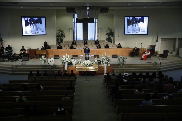 A pastor eulogizes Robert Fuller as attendees practice social distance during a funeral in his honor Tuesday, June 30, 2020, in Littlerock, Calif. Fuller, a 24-year-old Black man was found hanging from a tree in a park in a Southern California high desert city. Authorities initially said the death of Fuller appeared to be a suicide but protests led to further investigation, which continues. (AP Photo/Marcio Jose Sanchez)