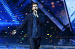 Duncan Laurence of the Netherlands performs his song,