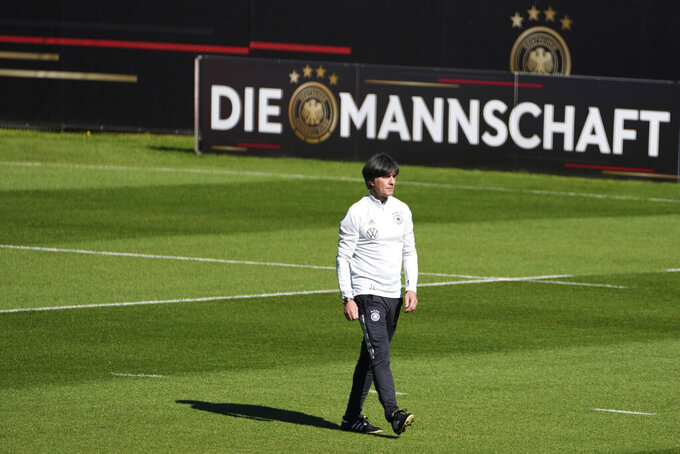 German head coach Joachim Loew watches his team during a first training session of the national soccer team in Seefeld, Austria, Friday, May 28, 2021. Team Germany is based for a training camp in Tyrol prior to the Euro 2020 from May 28 till June 6, 2021. (AP Photo/Matthias Schrader)