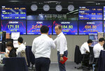 Currency traders work at the foreign exchange dealing room of the KEB Hana Bank headquarters in Seoul, South Korea, Monday, May 27, 2019. Shares were mixed early Monday in Asia in the absence of fresh news on the tariffs standoff between the U.S. and China. (AP Photo/Ahn Young-joon)