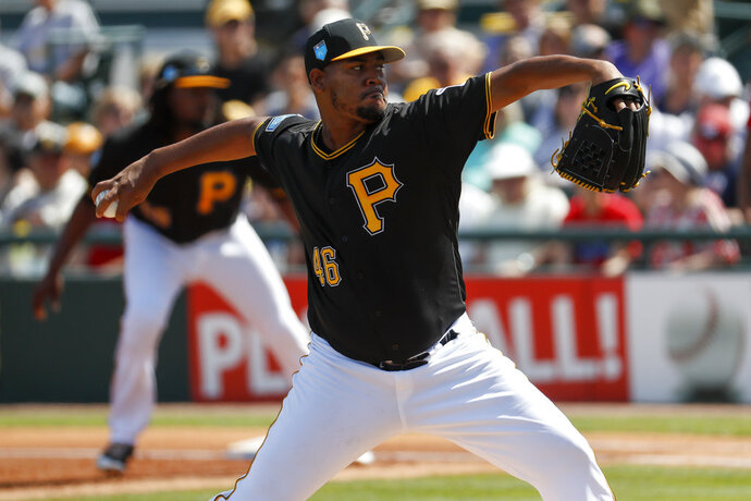 FILE - In this Feb. 26, 2018, file photo, Pittsburgh Pirates starting pitcher Ivan Nova throws in the first inning of a spring training baseball game against the Boston Red Sox, in Bradenton, Fla. Nine years into his career, Nova is the ace of a pitching staff. The Pirates Opening Day starter is eager to prove it's not by default. (AP Photo/John Minchillo, File)