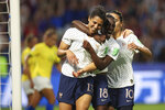 France's Valerie Gauvin, left, celebrates with France's Viviane Asseyi, center, and France's Amel Majri after scoring her side's first goal during the Women's World Cup round of 16 soccer match between France and Brazil at the Oceane stadium in Le Havre, France, Sunday, June 23, 2019. (AP Photo/Francisco Seco)