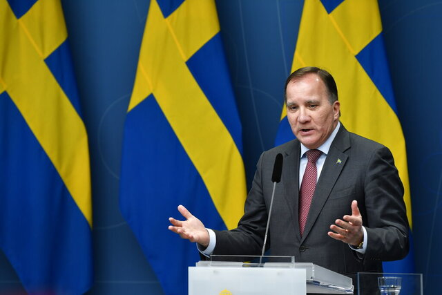 Sweden's Prime Minister Stefan Lofven gives a news conference on new restrictions to curb the spread of the coronavirus pandemic, in Stockholm, Sweden, Wednesday Nov. 11, 2020. The Swedish government proposes a stop the sale of alcohol after 10 pm from Nov. 20 until the end of February. (Henrik Montgomery / TT via AP)
