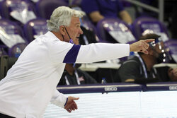 Kansas State coach Bruce Weber gestures during the team's NCAA college basketball game against TCU on Saturday, Feb. 20, 2021, in Fort Worth, Texas. (AP Photo/Richard W. Rodriguez)