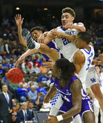 Abilene Christian's Payten Ricks, back left, and Trey Lenox, front, go after a rebound against Kentucky's Reid Travis, center, and Keldon Johnson, right, during the second half of a first-round game in the NCAA men's college basketball tournament in Jacksonville, Fla., Thursday, March 21, 2019. (AP Photo/Stephen B. Morton)