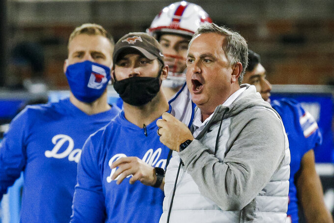 SMU head coach Sonny Dykes argues a call during an NCAA college football game against Navy, Saturday, Oct. 31, 2020, in Dallas. SMU won 51-37. No. 18 SMU has a clear path to the American Athletic Conference title game after rebounding from its only loss, as long as the Mustangs keep winning. The Mustangs (6-1, 3-1 American) are at struggling and undermanned Temple on Saturday, Nov. 7, a game that was pushed back two days by the conference to allow for the best chance of it being played this week. (AP Photo/Brandon Wade)