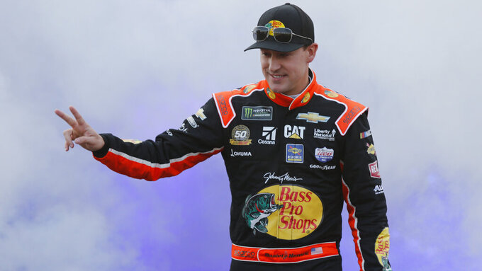 Daniel Hemric waves to fans during driver introductions prior to the start of the NASCAR Cup series auto race at Richmond Raceway in Richmond, Va., Saturday, April 13, 2019. (AP Photo/Steve Helber)