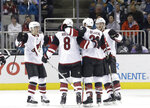 Arizona Coyotes defenseman Alex Goligoski, second from right, celebrates with teammates after scoring a goal against the San Jose Sharks during the second period of an NHL hockey game in San Jose, Calif., Tuesday, Feb. 13, 2018. (AP Photo/Jeff Chiu)
