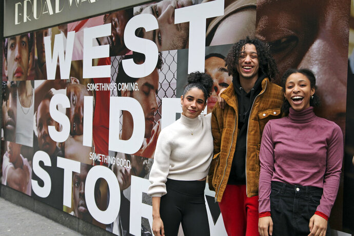 In this Tuesday, Feb. 18, 2020 photo, from left, Ilda Mason, Israel Del Rosario and Satori Folkes-Stone pose outside the Broadway Theatre in New York, where they are making their Broadway debuts in