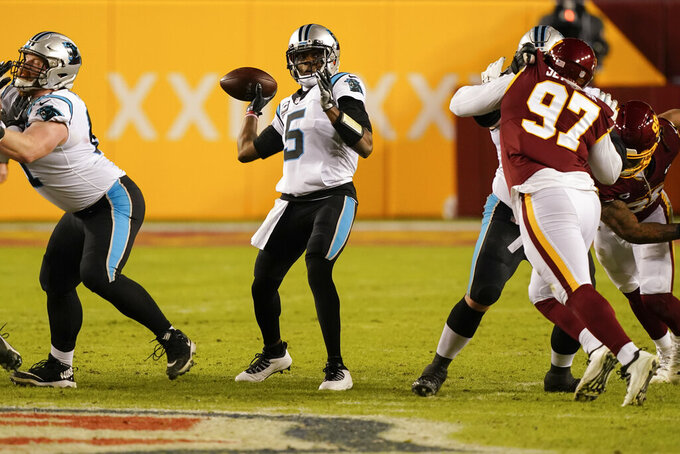 Carolina Panthers quarterback Teddy Bridgewater (5) passing the ball during the first half of an NFL football game against the Washington Football Team, Sunday, Dec. 27, 2020, in Landover, Md. (AP Photo/Susan Walsh)