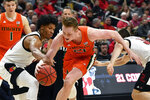 Miami forward Sam Waardenburg (21) works between Louisville defenders, including forward Dwayne Sutton (24), during the first half of an NCAA college basketball game in Louisville, Ky., Tuesday, Jan. 7, 2020. (AP Photo/Timothy D. Easley)