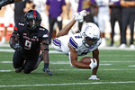 Stephen F. Austin's Xavier Gipson (2) is tackled during the first half of the team's NCAA college football game against Texas Tech, Saturday, Sept. 11, 2021, in Lubbock, Texas. (AP Photo/Brad Tollefson)
