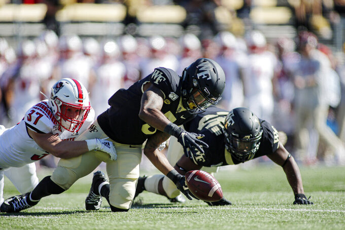 Wake Forest's Steven Claude, center, tries to beat North Carolina State's Tyler Dabbs, right, to kickoff fumble during the first half of an NCAA college football game in Winston-Salem, N.C., Saturday, Nov. 2, 2019. (AP Photo/Nell Redmond)