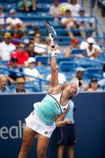 Ashleigh Barty, of Australia, serves to Maria Sharapova, of Russia, at the Western & Southern Open tennis tournament Wednesday, Aug. 14, 2019. in Mason, Ohio. (Meg Vogel/The Cincinnati Enquirer via AP)