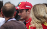 Ferrari driver Charles Leclerc of Monaco, center, walks in the pit lane after qualification ahead of the Belgian Formula One at Spa-Francorchamps, Belgium, Saturday, Aug. 31, 2019. The Belgian Formula One race will take place on Sunday. (AP Photo/Francisco Seco)