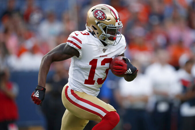 San Francisco 49ers wide receiver Richie James (13) runs against the Denver Broncos during an NFL preseason football game, Monday, Aug. 19, 2019, in Denver. (AP Photo/David Zalubowski)