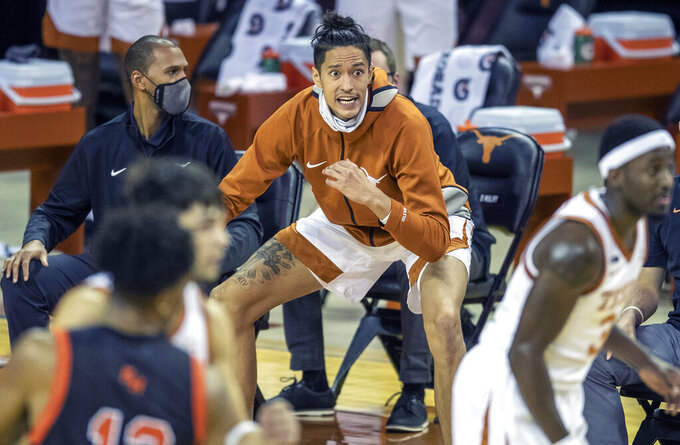 Texas forward Kamaka Hepa (33) cheers on his teammates during the first half of an NCAA college basketball game against Sam Houston State, Wednesday, Dec. 16, 2020 in Austin, Texas. (Ricardo B. Brazziell/Austin American-Statesman via AP)