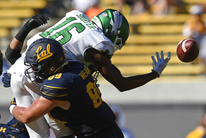 FILE - In this Sept. 14, 2019, file photo, California's Evan Weaver (89) tackles North Texas' Jyaire Shorter (16) while attempting to catch a pass on fourth down in the fourth quarter of on NCAA college football game, in Berkeley, Calif. Weaver was selected to the AP Midseason All-America NCAA college football team, Tuesday, Oct. 15, 2019.  (Jose Carlos Fajardo/San Jose Mercury News via AP, File)