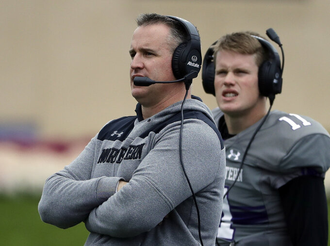 FILE - In this Oct. 27, 2018, file photo, Northwestern head coach Pat Fitzgerald, left, watches his team during the second half of an NCAA college football game against Wisconsin in Evanston, Ill. The program's winningest coach by a wide margin, Fitzgerald has No. 21 Northwestern playing in the Big Ten championship game for the first time. (AP Photo/Nam Y. Huh, File)