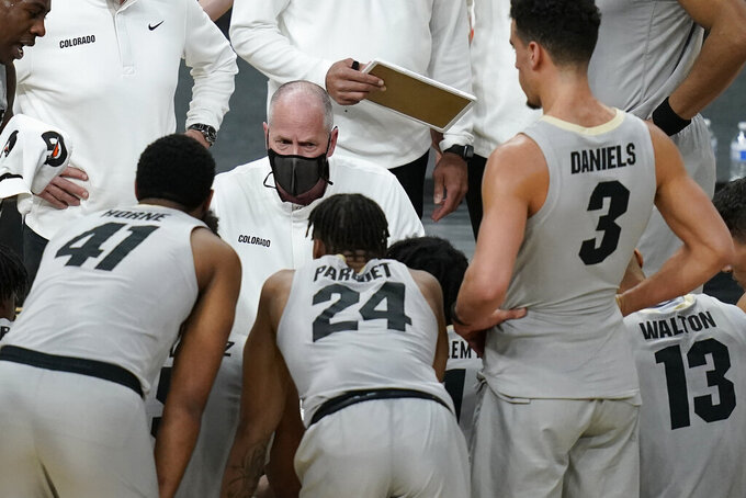 Colorado head coach Tad Boyle speaks with his players at at timeout during the second half of an NCAA college basketball game against California in the quarterfinal round of the Pac-12 men's tournament Thursday, March 11, 2021, in Las Vegas. (AP Photo/John Locher)