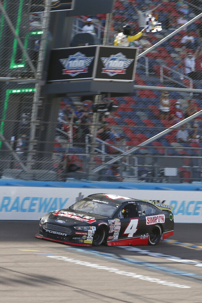 David Gilliland (4) crosses the finish line to win an ARCA Series auto race at Phoenix Raceway, Saturday, Nov. 7, 2020, in Avondale, Ariz. (AP Photo/Ralph Freso)