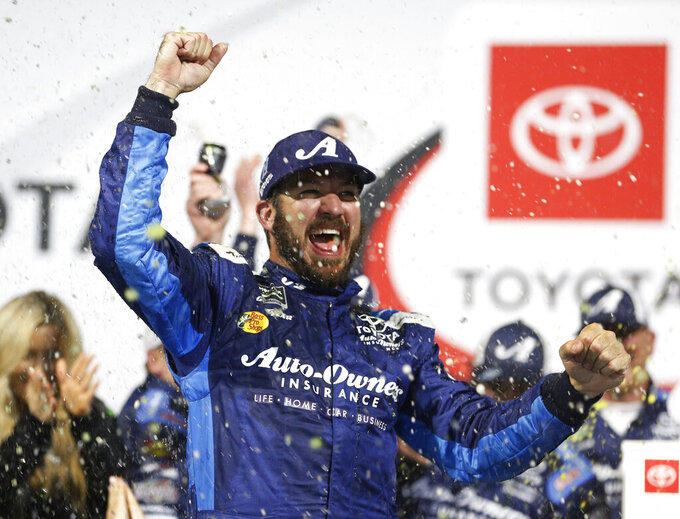 Martin Truex Jr. celebrates in Victory Lane after winning the NASCAR Cup Series auto race at Richmond Raceway in Richmond, Va., Saturday, April 13, 2019. (AP Photo/Steve Helber)