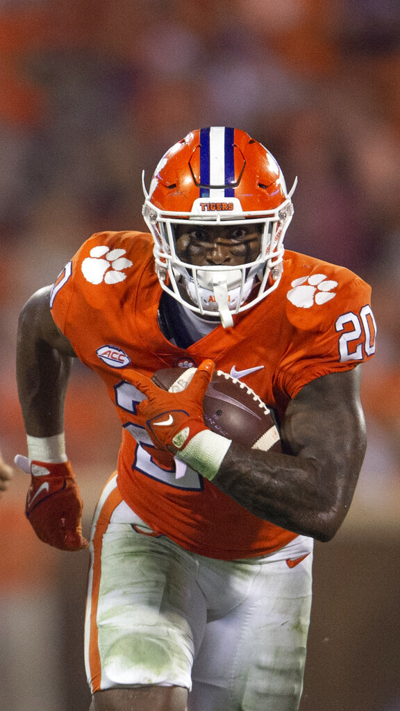 Clemson running back Kobe Pace (20) rushes with the ball during the second half of an NCAA college football game, against Boston College Saturday, Oct. 2, 2021, in Clemson, S.C. (AP Photo/Hakim Wright Sr.)