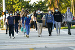 Students arrive for classes at Mast Academy, Tuesday, Oct. 13, 2020, in Miami. The maritime and science technology magnet high school was closed for one day this week after two students reported having the COVID-19 virus. (AP Photo/Lynne Sladky)